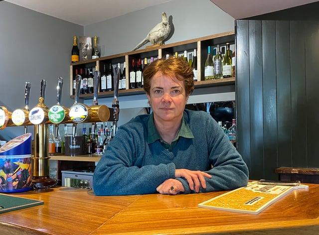Karina Bowlby behind the bar of the Fat Pheasant