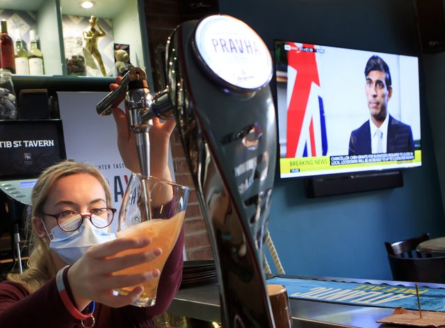 An employee pulls a pint in the Tib Street Tavern in Manchester, as Chancellor Rishi Sunak announces an extension to the Jobs Support Scheme