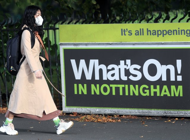 A woman wearing a face covering in Nottingham