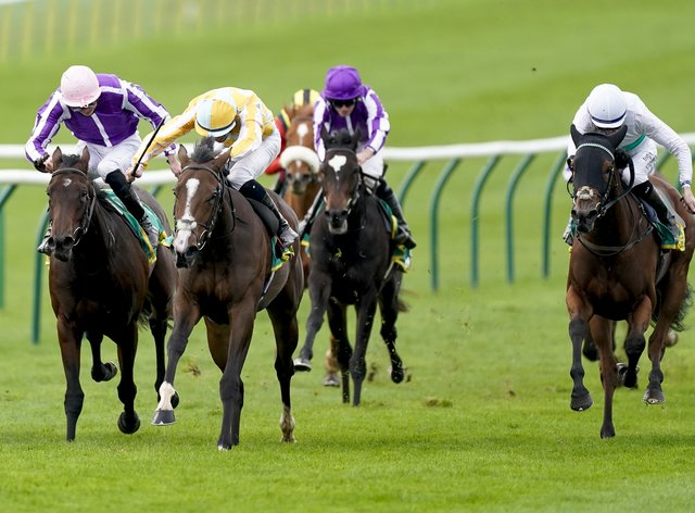 Mother Earth (left) was actually third past the post in the Fillies' Mile