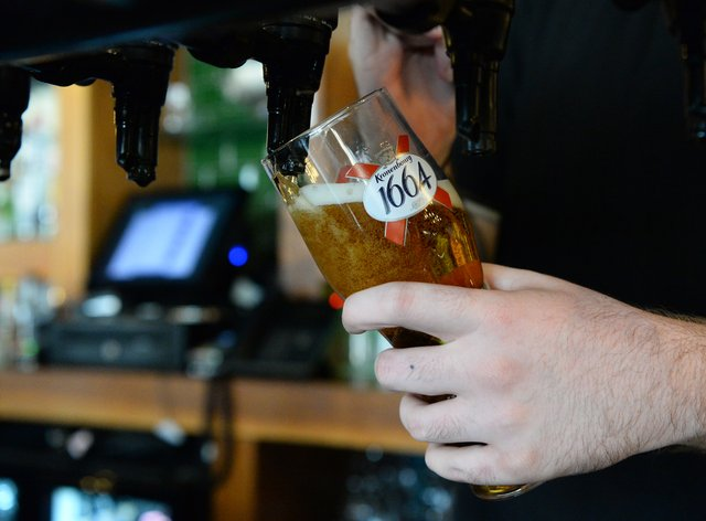 Bartender pouring a pint