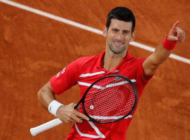 Novak Djokovic celebrates his narrow victory over Stefanos Tsitsipas