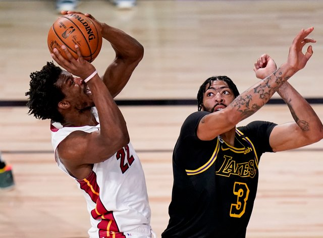 Miami Heat forward Jimmy Butler shoots over Los Angeles Lakers forward Anthony Davis