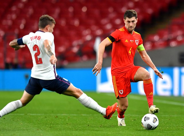 Wales's Ben Davies, right, in action against England