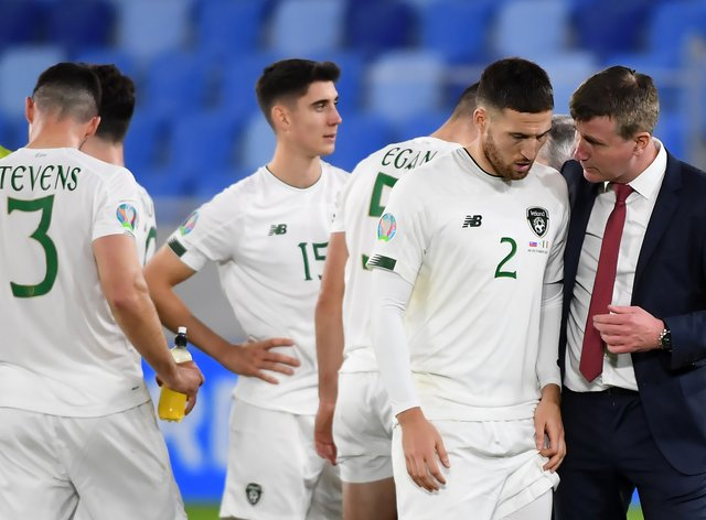 Matt Doherty is consoled by Republic of Ireland head coach Stephen Kenny after missing the decisive penalty in the shoot-out against Slovakia