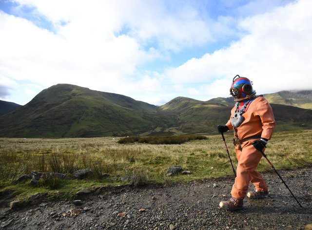 Veteran fundraiser Lloyd Scott, who is attempting to climb the Three Peaks in aid of Lord's Taverners charity whilst wearing a deep sea diving suit during his challenge on the final peak, Mount Snowdon in Snowdonia, north Wales.