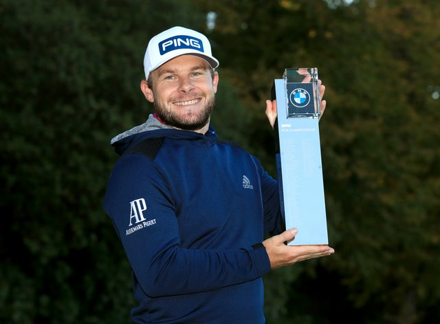 Tyrrell Hatton poses with the trophy after winning the BMW PGA Championship