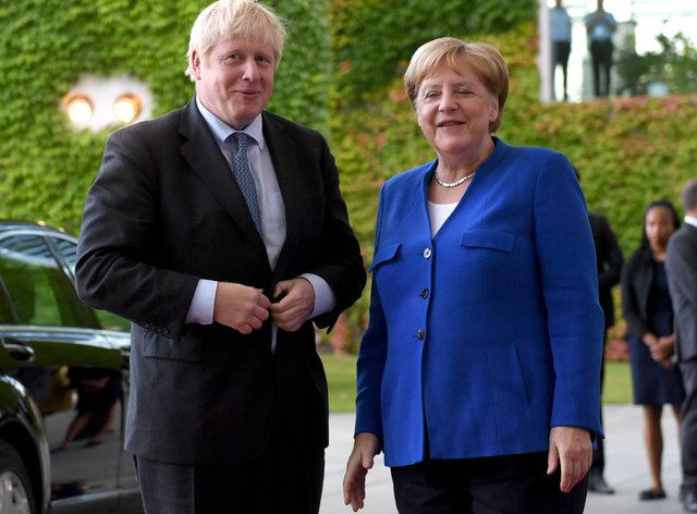 Prime Minister Boris Johnson during a Berlin meeting with German Chancellor Angela Merkel (Stefan Rousseau/PA)