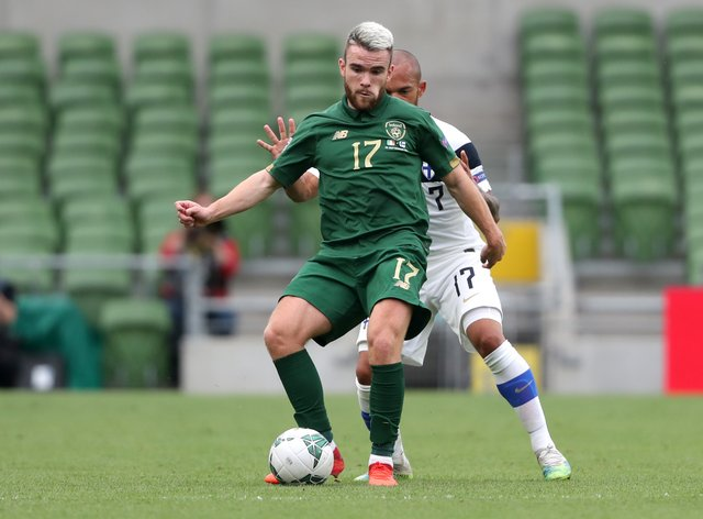 Aaron Connolly (left) missed the Euro 2020 play-off semi-final defeat in Bratislava after being withdrawn from the squad