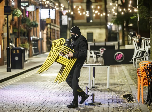 Bar staff clearing away tables for the evening in Manchester (Danny Lawson/PA)