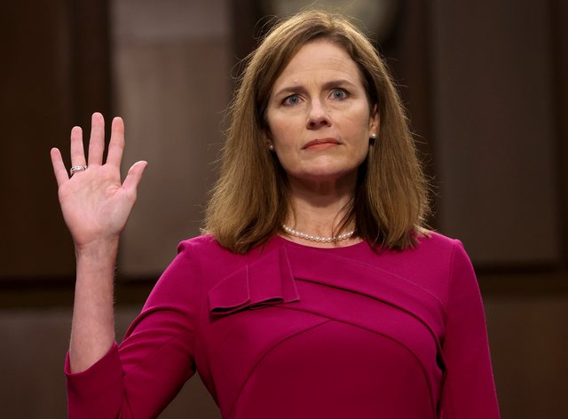Supreme Court nominee Amy Coney Barrett is sworn in for her confirmation hearing (Win McNamee/AP)