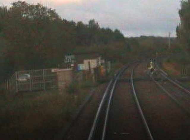 A cyclist crosses the tracks