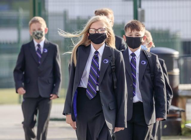 Pupils wearing protective face masks