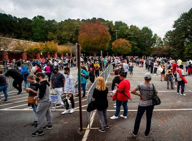 Hundreds of people wait for early voting in Marietta, Georgia