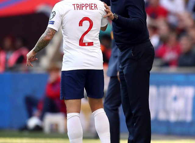 England manager Gareth Southgate speaks to Kieran Trippier