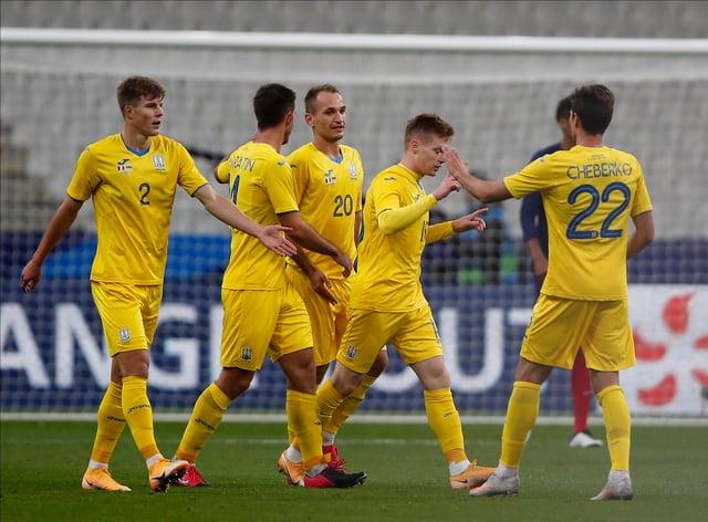 Viktor Tsygankov (second right) celebrates Ukraine's winner over Spain.