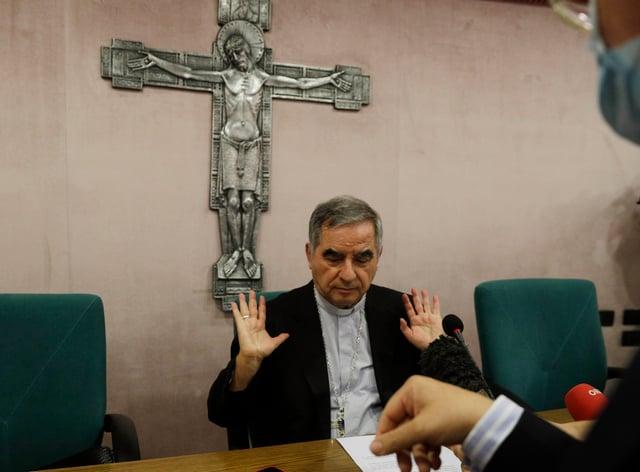 Cardinal Angelo Becciu talks to journalists (Gregorio Borgia/AP)