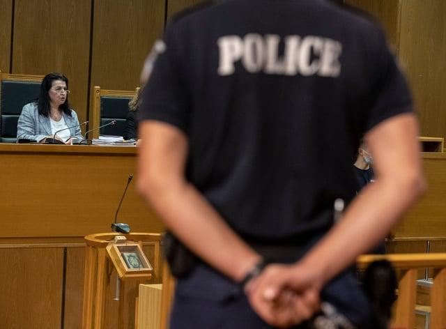 Presiding judge Maria Lepenioti reads the sentences (Petros Giannakouris/AP)