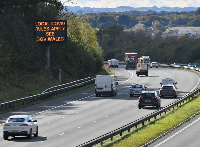 A matrix sign on the M4 motorway near Cardiff in Wales reminds motorists of coronavirus rules