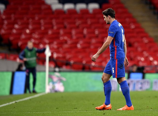 Harry Maguire walks off the pitch