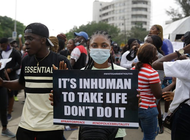 People demonstrate on the street to protest against police brutality in Lagos, Nigeria (Sunday Alamba/AP)