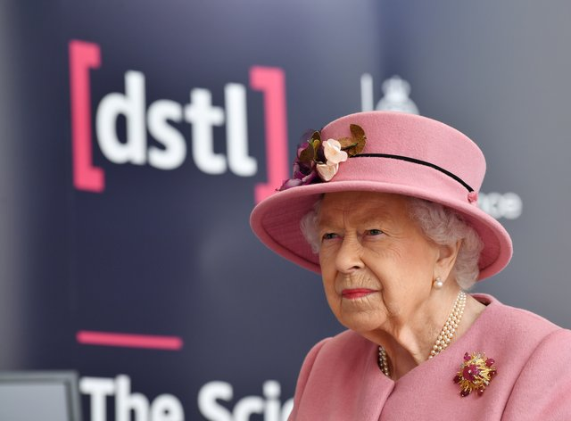 The Queen, with hat as usual, but no facemask