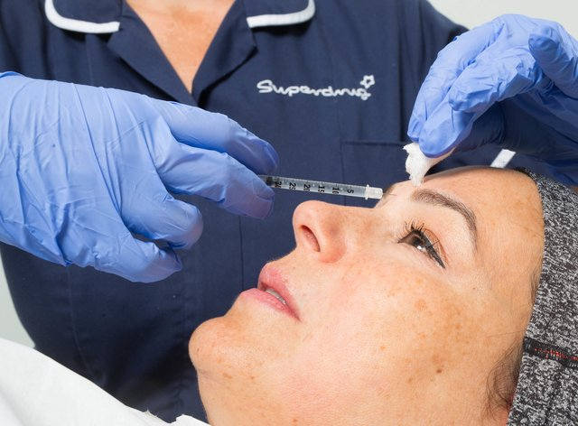 A woman undergoes treatment with Superdrug's Skin Renew Service