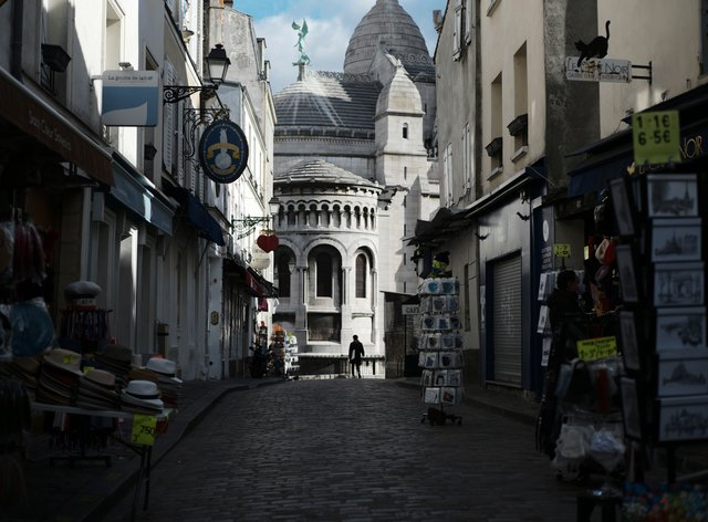 Tourists shops are empty in a deserted street just outside the Sacre Coeur basilica in the Montmartre district of Paris (Lewis Joly/PA)