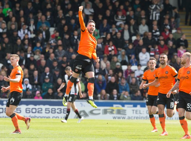 Dundee United striker Nicky Clark is determined to keep his place in Micky Mellon's team despite the arrival of Marc McNulty
