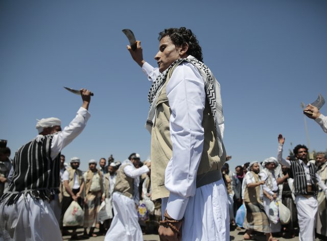 A Yemeni prisoner, centre, performs a traditional dance during his arrival after being released by the Saudi-led coalition (Hani Mohammed/AP)