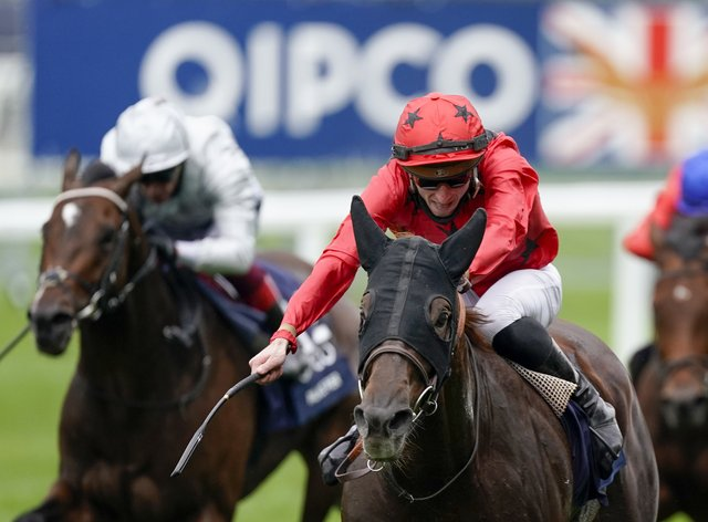 The Revenant ridden by Pierre-Charles Boudot (red) wins the Queen Elizabeth II Stakes