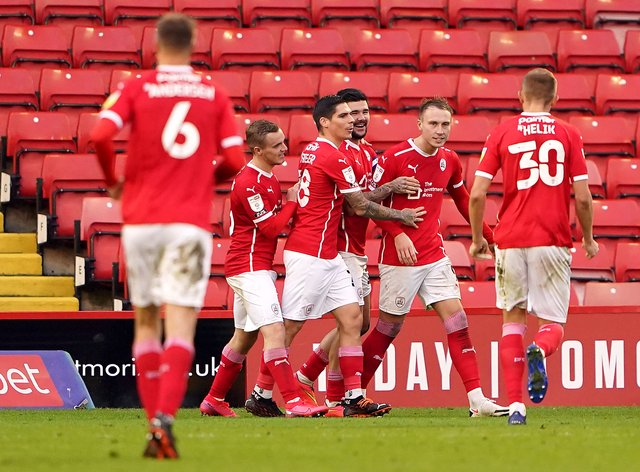 Barnsley's Cauley Woodrow (second right) celebrates his late equaliser