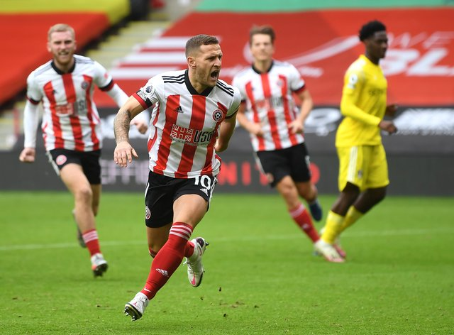 Substitute Billy Sharp celebrates scoring a late Sheffield United equaliser from the penalty spot against Fulham.