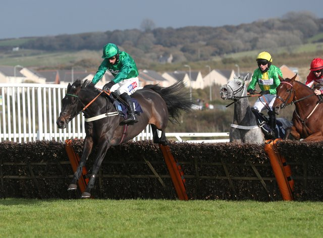 Sceau Royal (left) on his way to winning the Welsh Champion Hurdle