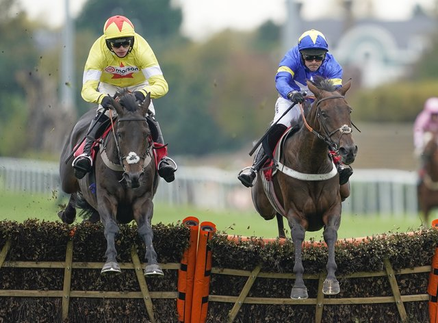 Mrs Hyde, ridden by Nico de Boinville (right), clears the last to win the Racing TV Novices' Hurdle at Kempton