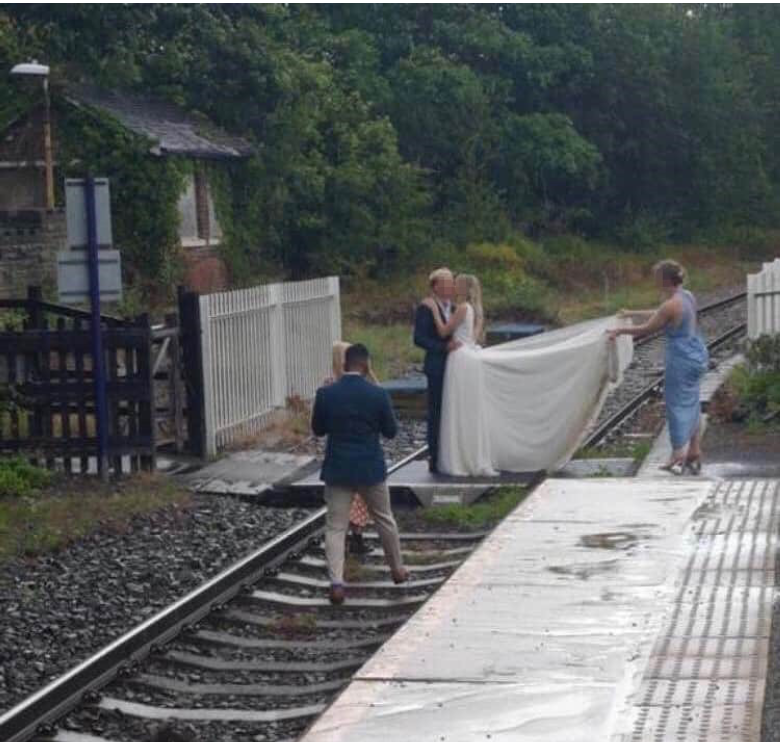 Bridal couple posing for wedding pictures among more than 5,000 railway trespassers since June