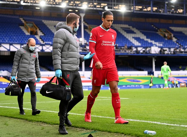 Virgil Van Dijk (right) is facing a number of months on the sidelines