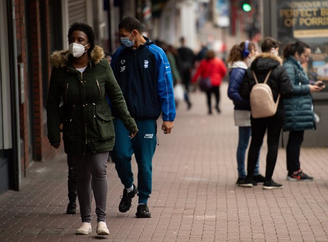 Shoppers wearing protective face masks