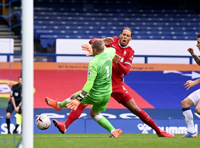 Liverpool defender Virgil Van Dijk (centre) is set for an extended spell on the sidelines