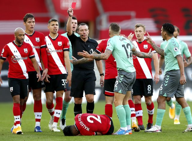 Everton's Lucas Digne is shown a red card by referee Kevin Friend