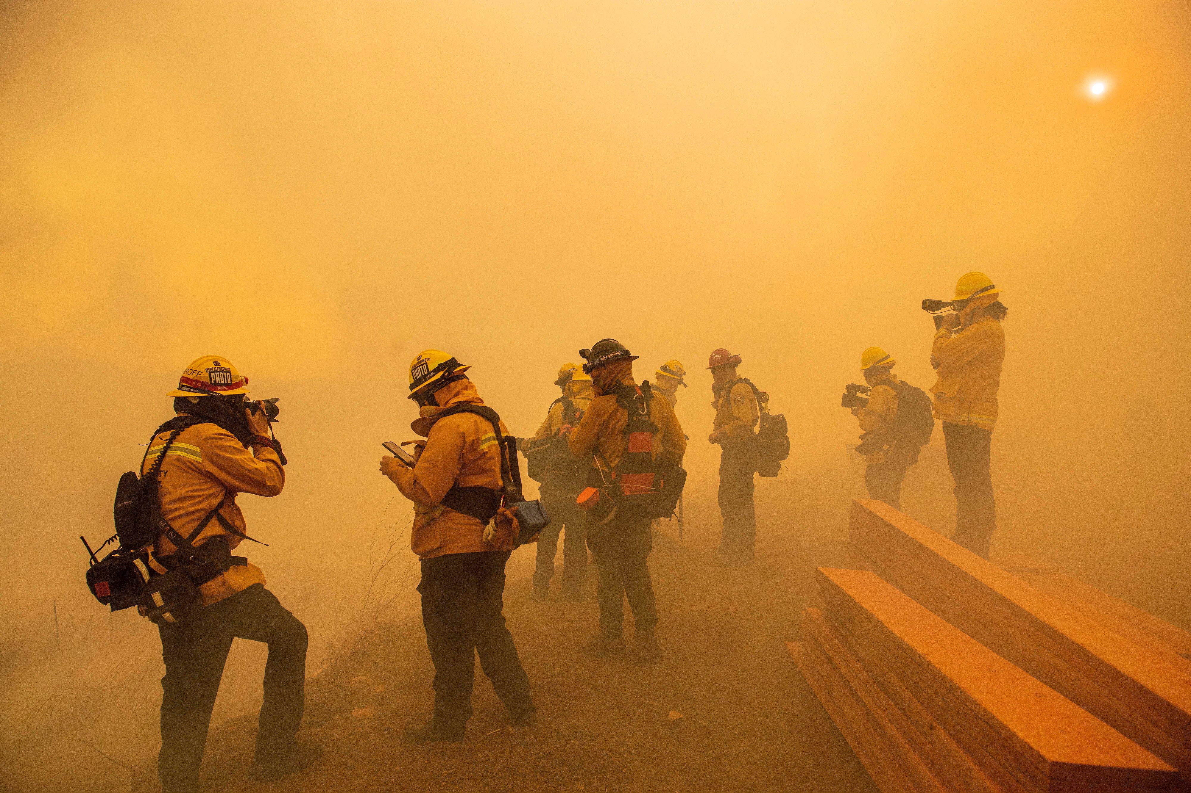 Thousands evacuated amid California fires