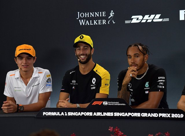 Norris (left) played down Hamilton's (right) achievements after he won his record-breaking 92nd Grand Prix last weekend