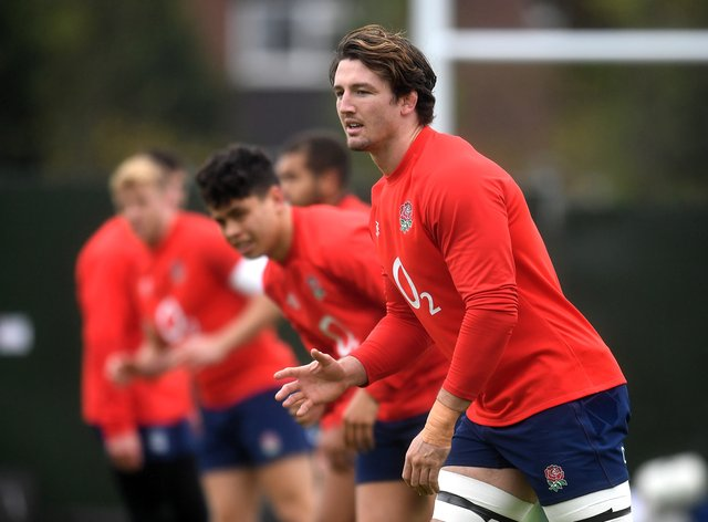 Tom Curry (right) is relishing England's back-row competition