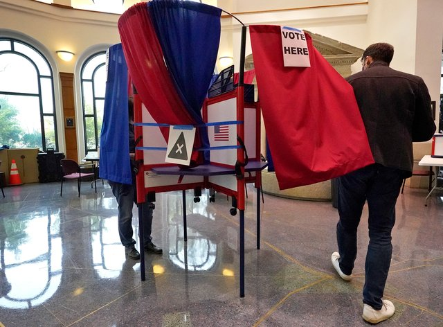 Voters cast their ballots during early voting in Cambridge, Massachusetts for the 2020 presidential election (Elise Amendola/AP)
