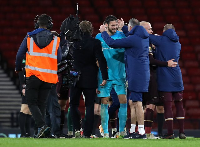 Hearts keeper Craig Gordon (centre) celebrates after a man-of-the-match performance in Hearts' 2-1 Scottish Cup semi-final win over Hibs