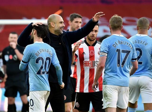 Pep Guardiola congratulates Bernardo Silva and Kevin De Bruyne after Manchester City's 1-0 win over Sheffield United at Bramall Lane.