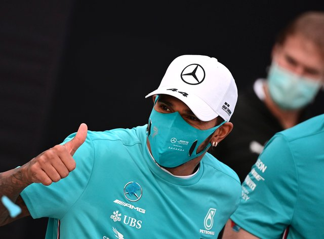 Lewis Hamilton, gives the thumbs up as he celebrates winning the Emilia Romagna Grand Prix but says he cannot guarantee racing on in 2021