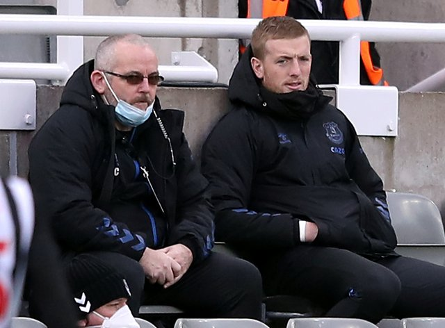 Everton goalkeeper Jordan Pickford (right) was on the bench at St James' Park