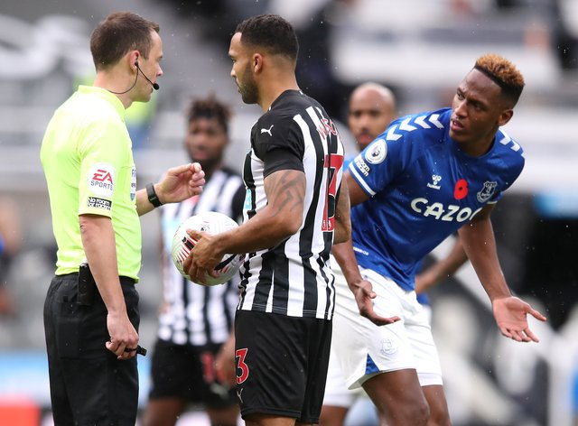 Everton's Yerry Mina (right) did his best to put off Newcastle's Callum Wilson as he prepared to take his penalty