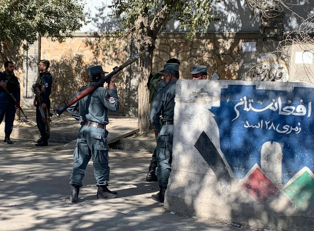 Afghan police at the site of an attack at Kabul University